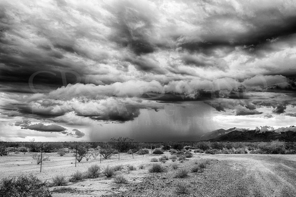 "2013, ""All Rights Reserved"", Arizona, August, B&W, ""Black & White"", Capture, Clouds, ""Crosswind Images"", ""Digital Photography"", ""Dirt Road"", ""Dramatic Sky"", ""Estrella Mountains"", Fence, Image, ""Jay Be"
